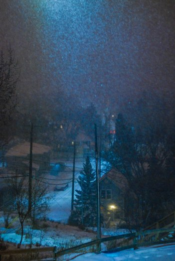 Snow sparkling in the sky over Riverdale